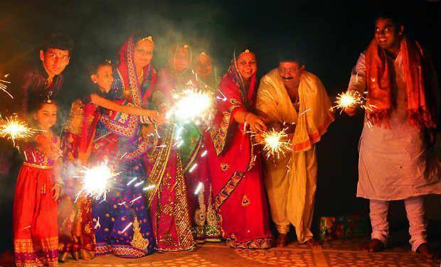 family pose for diwali 2021