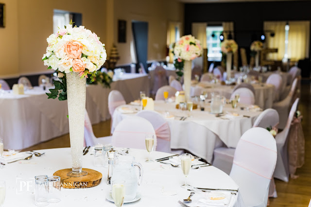 backworth hall wedding room, large vases on tables