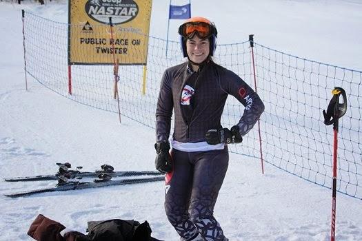 Skier in black posing