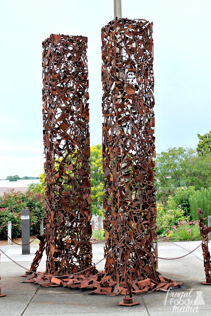 "This  20 foot tall ""World Trade Center: Sculpture of Steel"" sculpture is located outside of the American Museum of Science & Energy."