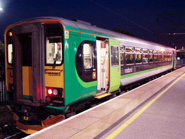 Night photo of London Midland City Train Class 153 364 DMU standing in a bay platform at Bedford railway station in 2015