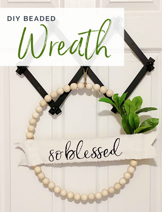 wreath hanging from pegs with overlay