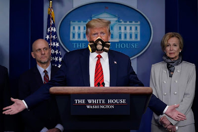 Trump covid-1 coronavirus press conference wearing a gas mask