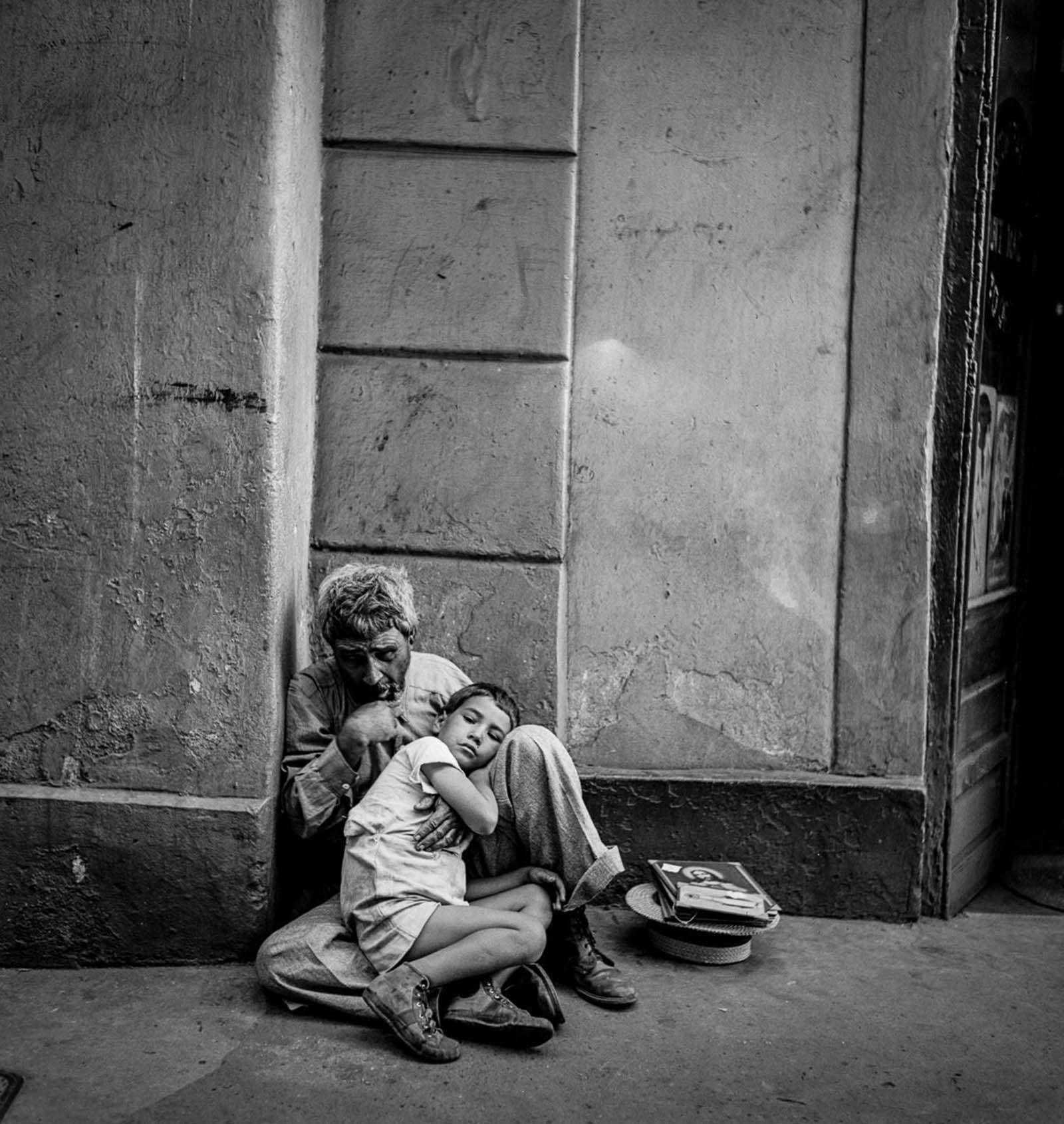 A beggar and child in San Juan.