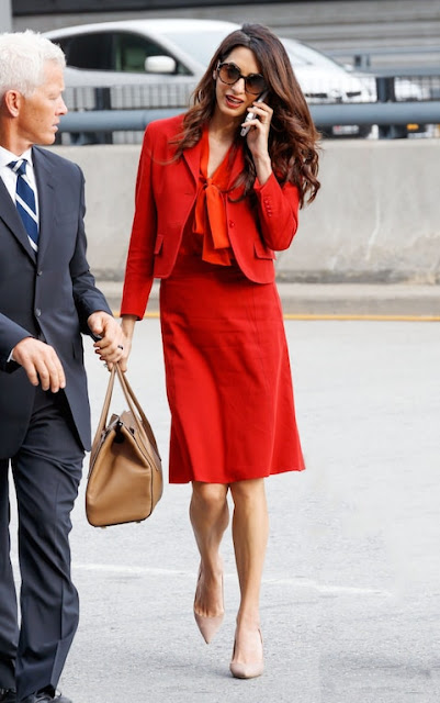 Amal Clooney in red skirt power suit for power dressing