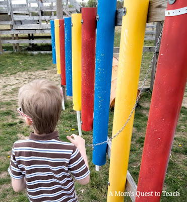 Boy playing outdoor musical instruments