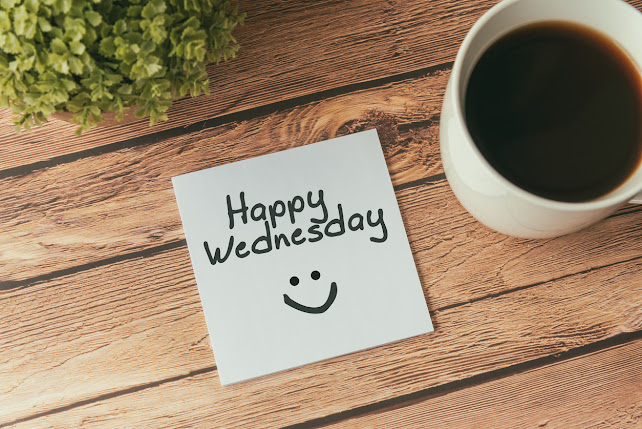 coffee cup with postit with HAPPY WEDNESDAY