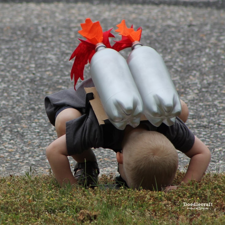 Rocket jet pack for child made of recycled materials diy craft with soda bottles and felt