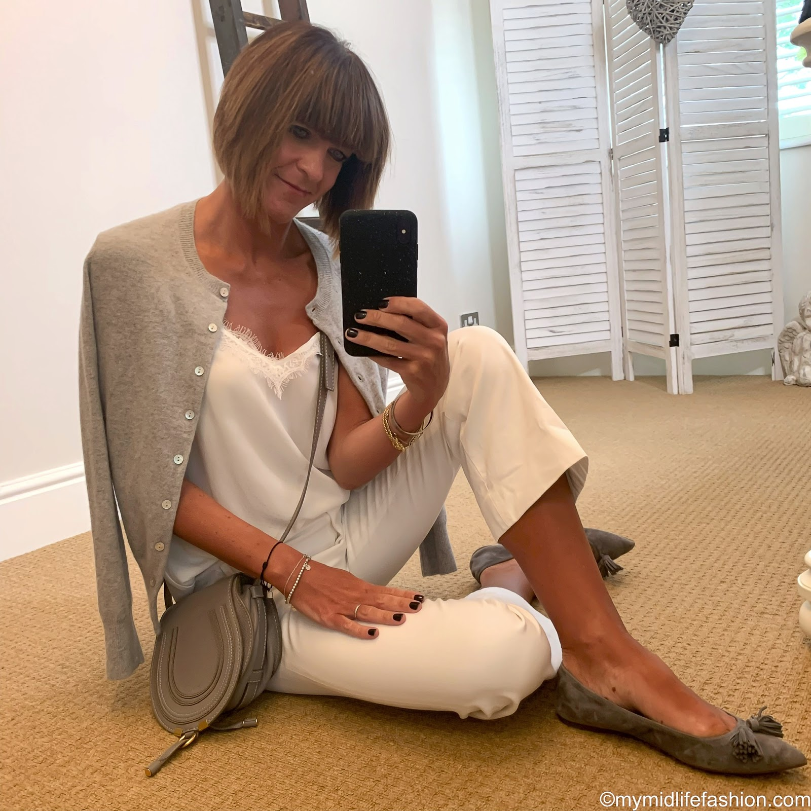 my midlife fashion, marks and Spencer pure cashmere round neck cardigan, Zara lace trim camisole, j crew cropped kick flare trousers, Chloe marci small cross body bag, j crew suede pointed tassel flats