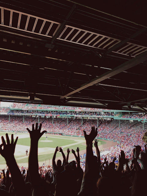 Crowd cheers at Fenway Park in Boston, Massachusetts