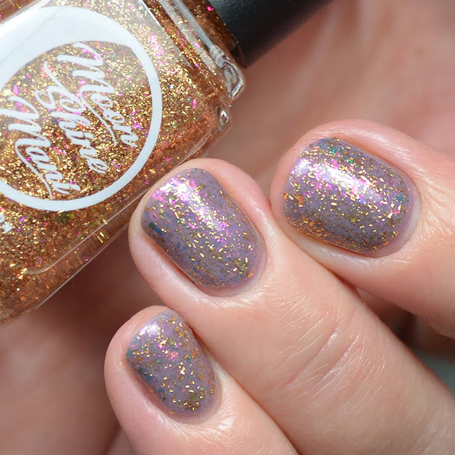 gold flakie nail polish topper swatch