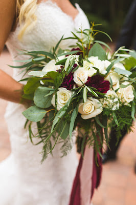white and maroon bridal bouquet