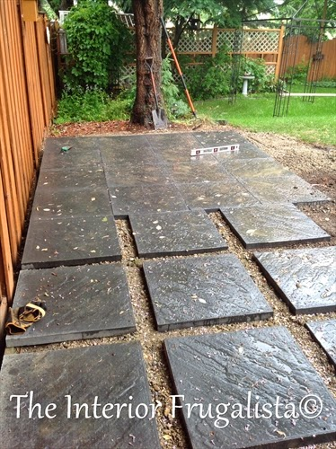 Patio pavers laid in a grid pattern for our outdoor living space expansion