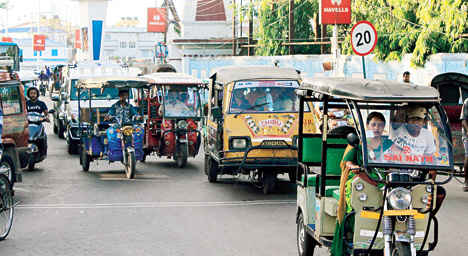 Toto-Auto slowing down traffic in Siliguri