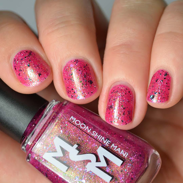 magenta nail polish with shimmer and flakies swatch
