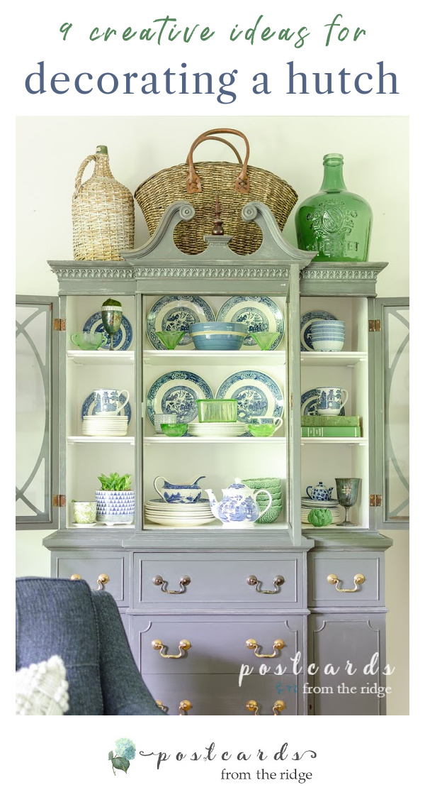 painted china cabinet with blue and white dishes