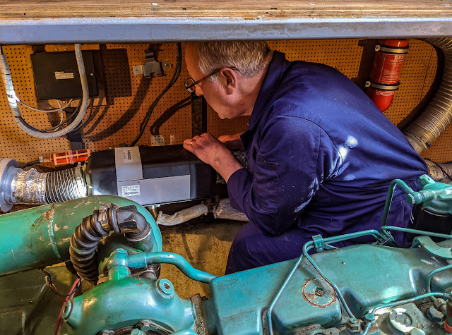 Photo of Phil working on Ravensdale's broken down Webasto heater
