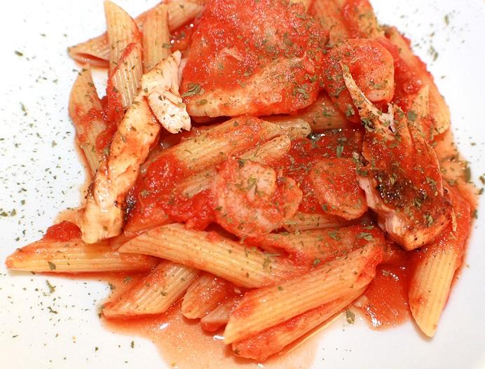 ziti with tuna marinara sauce on top