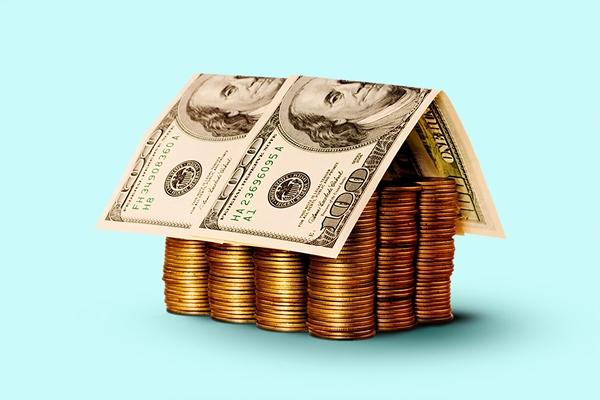 Imagem de divulgação moedas empilhadas com notas em cima perfazendo um telhado