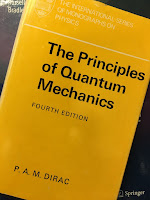 The Principles of Quantum Mechanics, by Paul Dirac, superimposed on Intermediate Physics for Medicine and Biology.