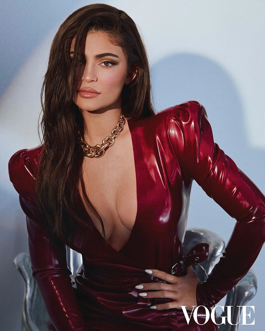 Kylie Jenner is a Vogue cover girl again as she smolders in plunging red latex gown and is praised for her 'strength and determination' in Hong Kong issue