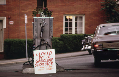 Gas pump with hand-lettered sign reading Closed do to gas shortage