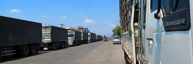 Trucks waiting in front of Friendship Bridge at Myanmar Thailand border.