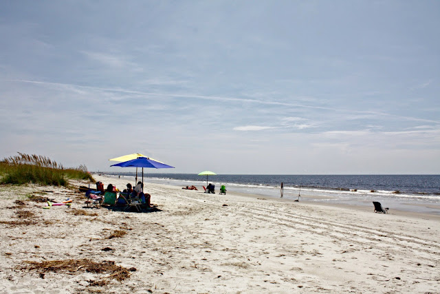 Families relaxing on Oak Island Beach