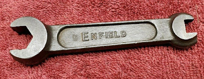 Double-ended wrench with ENFIELD on it.