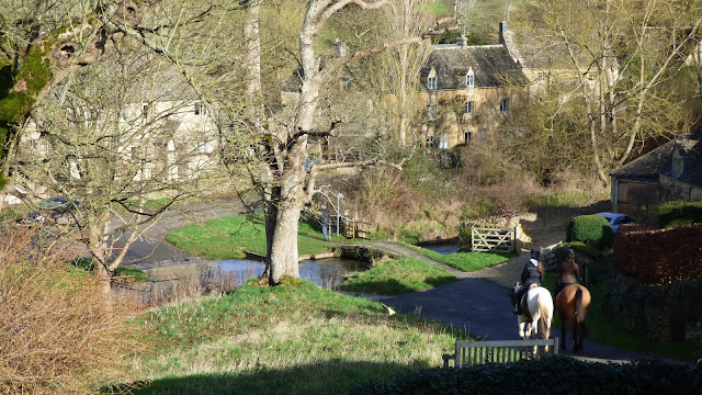 Horses head down to the ford, which crosses the River Eye - Upper Slaughter, Cotswolds