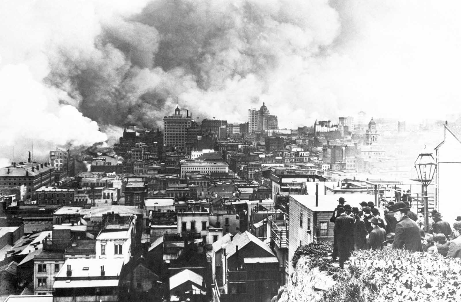 A crowd gathers on Telegraph Hill to watch the burning of San Francisco. The view is looking south.