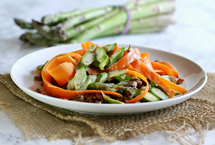 Recipe for a salad made with flax, asparagus and carrots topped with a tahini vinaigrette.