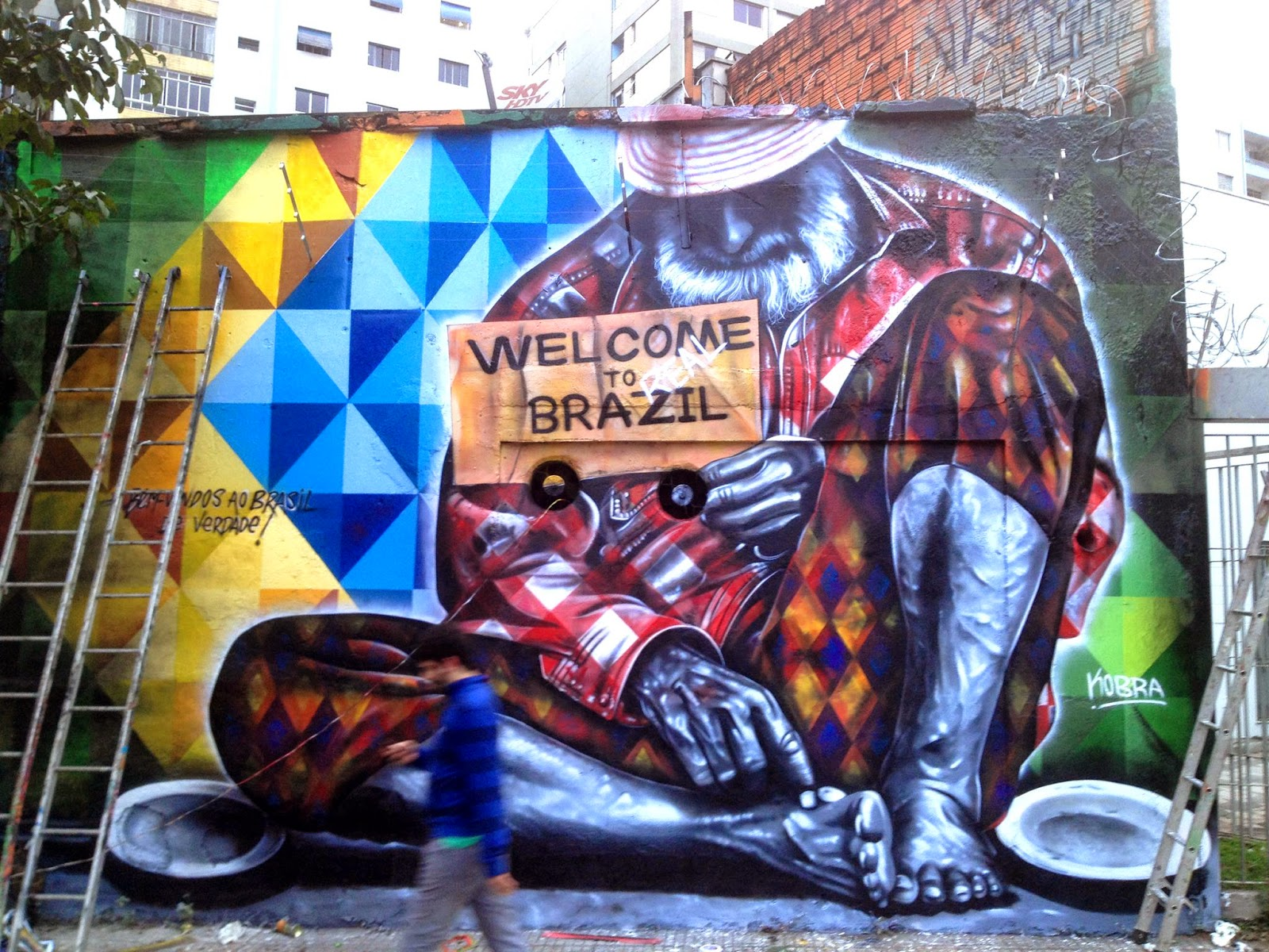 """Eduardo Kobra is back in Sao Paulo where he spent the last few days working on this new piece entitled """"Welcome To Real Brazil"""" to commemorate the recent opening of the Brazilian World Cup."""