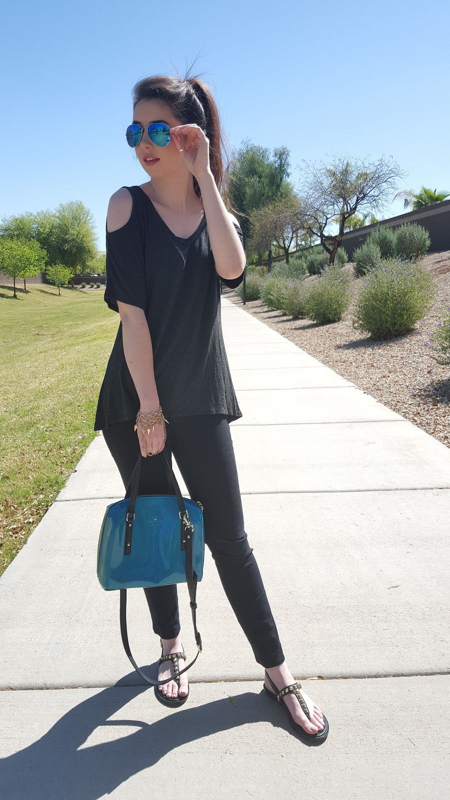 simple trendy Spring outfit with a cold shoulder tee and studded sandals