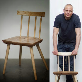 Image of a wooden dining chair next to a man leaning on the chair he has made