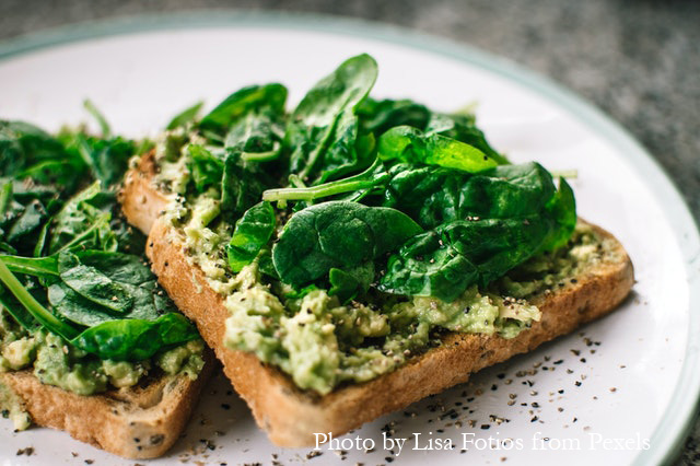 Avocado with basil leaves on toast