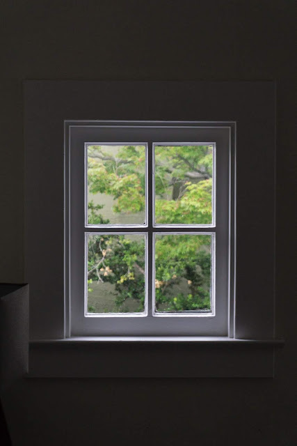 Gray Wooden Windowpane | Photo by Nicolas Solerieu via Unsplash