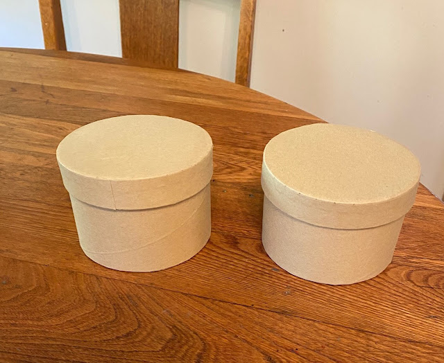 Photo of two round Dollar Tree Boxes