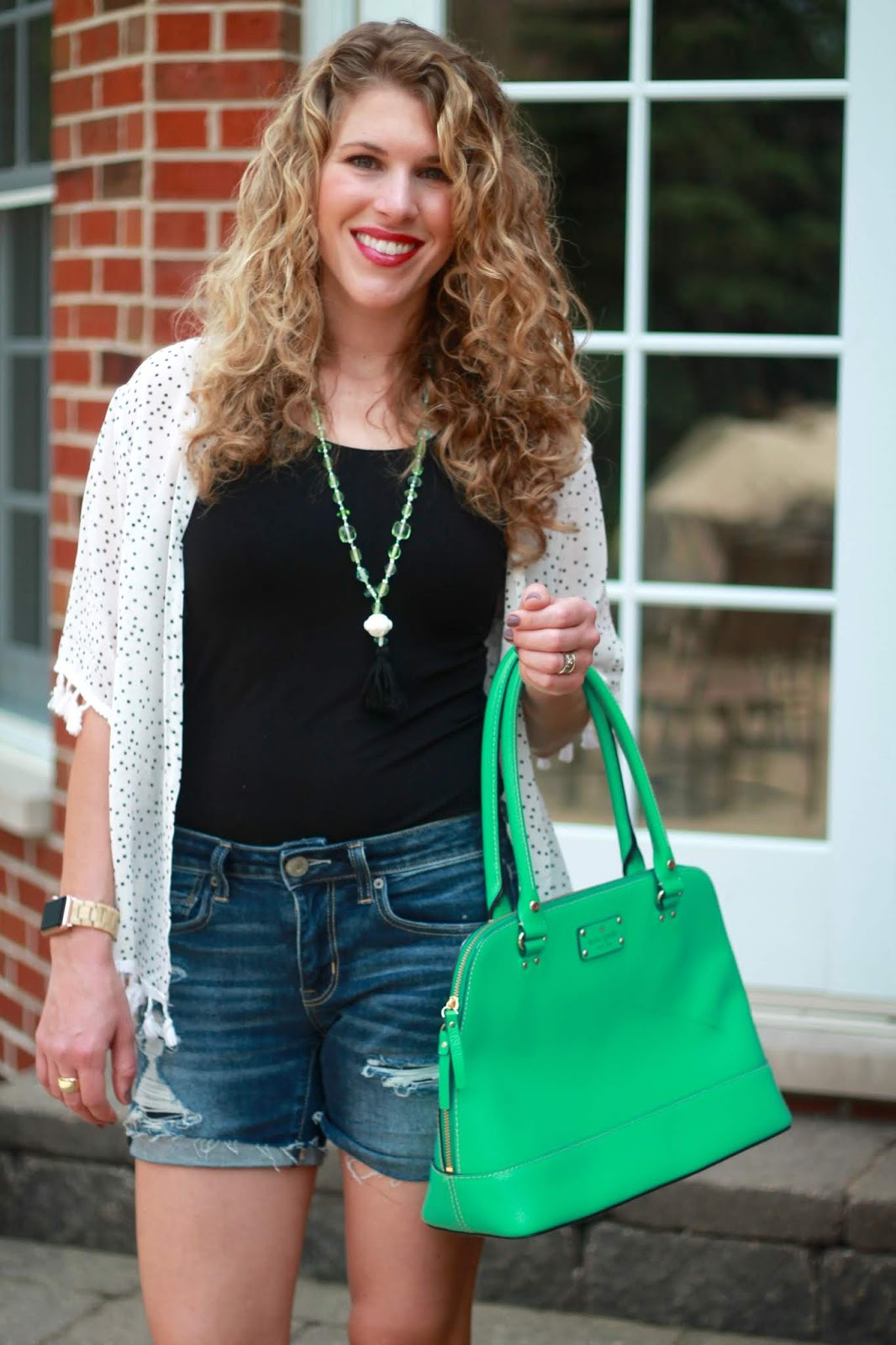 polka dot kimono, distressed denim shorts, mint green Kate Spade bag, cognac wedges