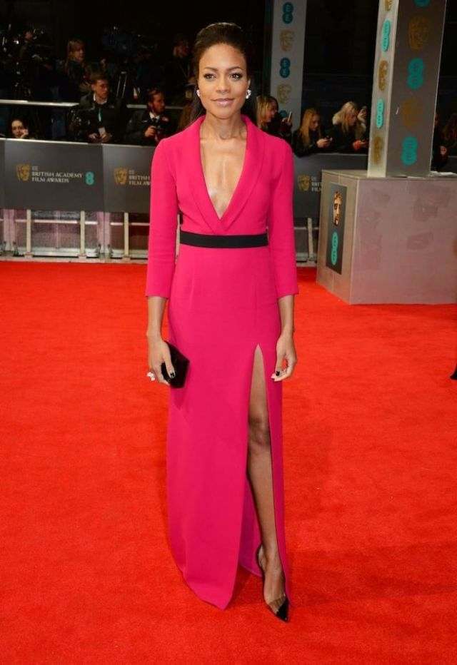 Naomie Harris in a hot pink Gucci design at the BAFTA 2014