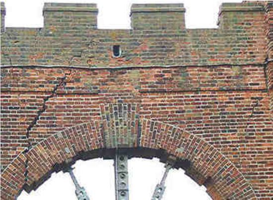 The crack in Folly Arch were first spotted in the autumn of 1998  Image from the North Mymms History Project released under Creative Commons