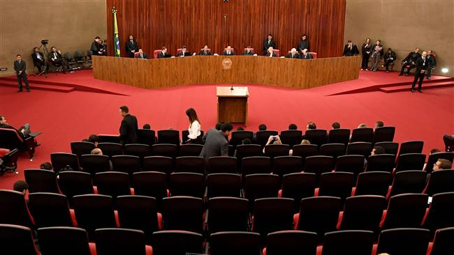 Brazil court votes not to oust President Michel Temer