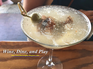 The black and bleu martini has a piece of tenderloin in it with bleu cheese stuffed olives