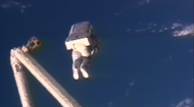 First jet pack flying out in space.