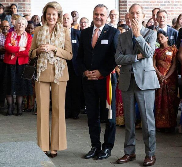 Queen Mathilde wore a beige pantsuit by Natan. Global Education Conference organized by VIA Don Bosco