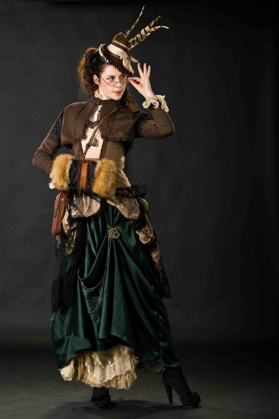 Steampunk woman wearing clothing in warm earthy tones (bustle skirt, bolero, hat, corset) and eyeglasses
