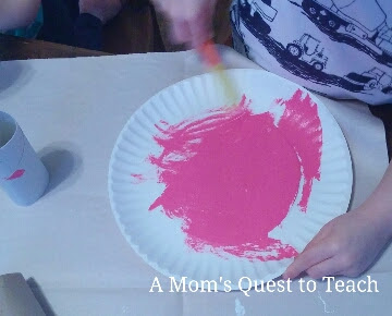painting a paper plate