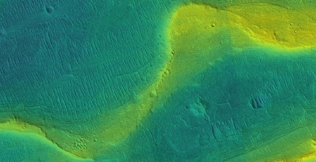 A photo of a preserved river channel on Mars with color overlaid to show different elevations (blue is low, yellow is high). Credit: Courtesy of NASA/JPL/Univ. Arizona/UChicago