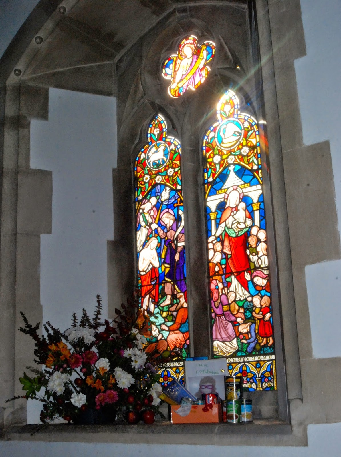 church window decorated for harvest festival
