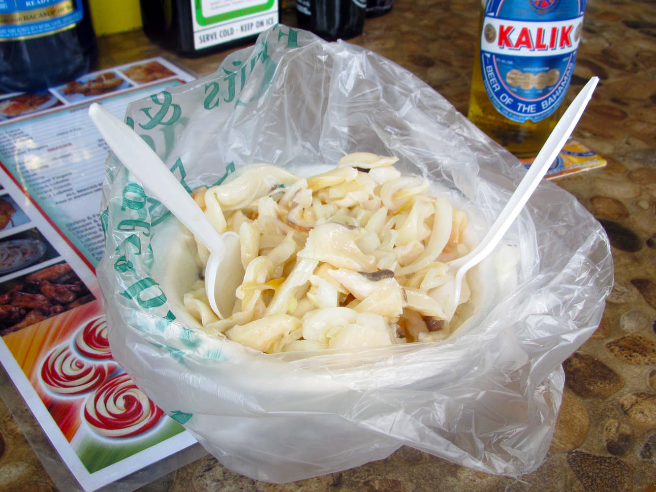 A bowl of freshly prepared conch salad without tomatoes served at Candies Enterprise restaurant, Arawak Cay, Nassau, Bahamas.